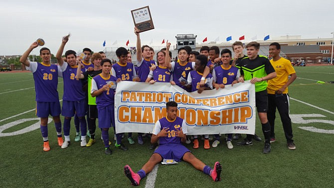 The Lake Braddock boys' soccer team defeated T.C. Williams 4-3 in overtime on May 20 to win the Conference 7 championship.