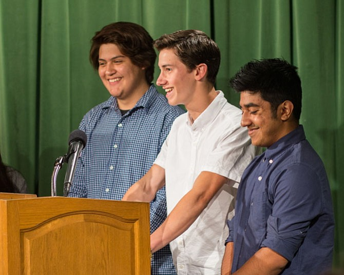 "From left: Jonathan Ibarra, Andrew Jones, and Rubaiyat Rhidoy, seniors at T.C. Williams High School received honorable mention in the 2016 C-SPAN StudentCam competition. They are now working on a documentary entitled ""Race to Gold"" about the two fastest high school sprinters, the Lyles brothers."