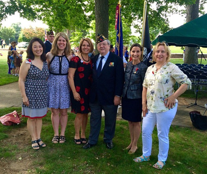 Attending the May 30 Memorial Day observance at Herndon's Chestnut Grove Cemetery were Herndon residents, including (from left) Town Councilmember Grace H. Wolf, Vice Mayor Jennifer Baker, Mayor Lisa Merkel, councilmember David Kirby, Del. Jennifer Boysko, and councilmember Sheila Olem.