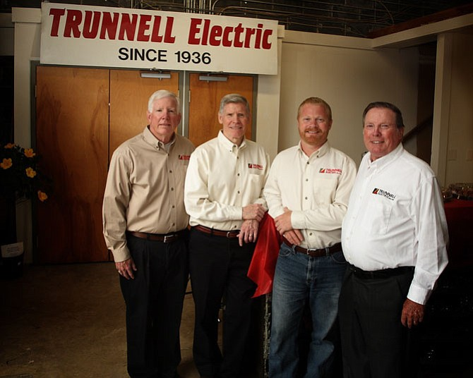 Leadership of Trunnell Electric at the 80th anniversary open house: (far left) Rick Trunnell, co-owner, residential operations manager; Jack Trunnell, co-owner, chief financial officer; Brad Trunnell, vice president of commercial services; (far right) Lee Trunnell, co-owner, president.