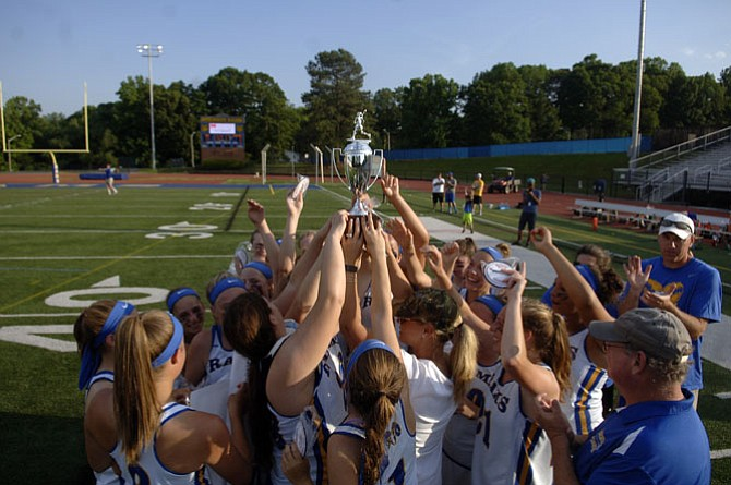 The Robinson girls' lacrosse team celebrates winning its second consecutive 6A North region championship on Tuesday.