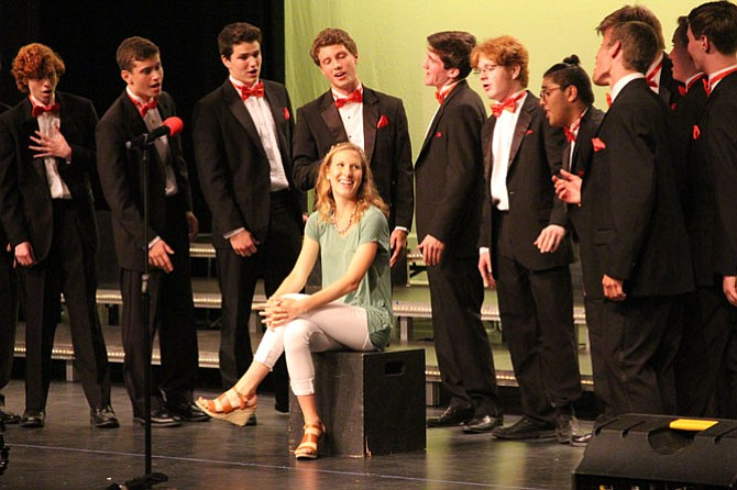 Meredith Hargroves, a freshman at the University of Virginia and alumna of Langley High School, was surprised by her boyfriend Matt Arrison who brought her onstage during the performance.