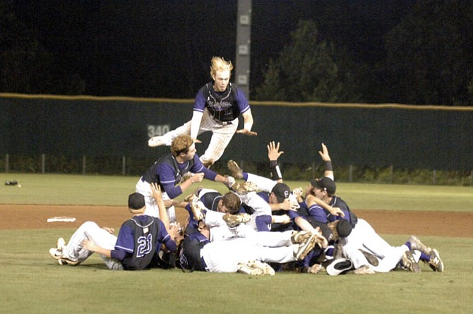 Members of the Chantilly baseball team celebrate winning the 6A North region championship on Friday.
