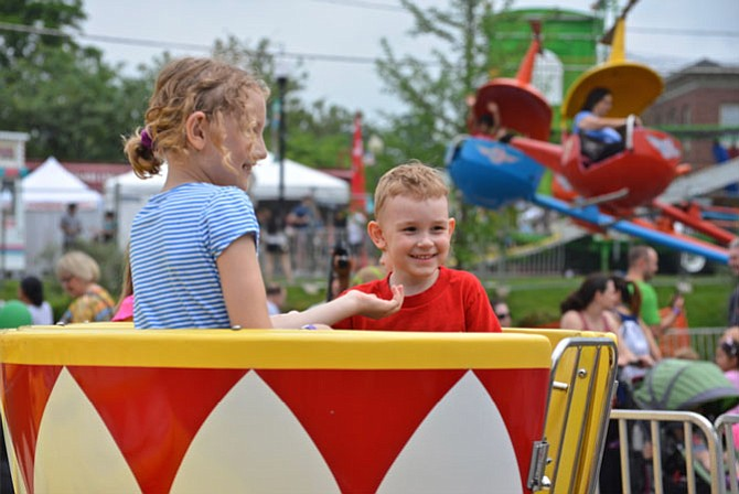 """Happy faces on the Tea Cup ride for Stephanie and Nate of Herndon. The youngsters were particularly pleased because unlike typical amusement park rides, """"the lines weren't long!"""""""