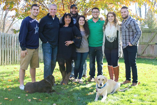 The Shock family has dealt with kidney failure and transplant before. From left, Logan, Ed, Mary Ann, Emery, Meredith, Austin, Madison and Hayden.