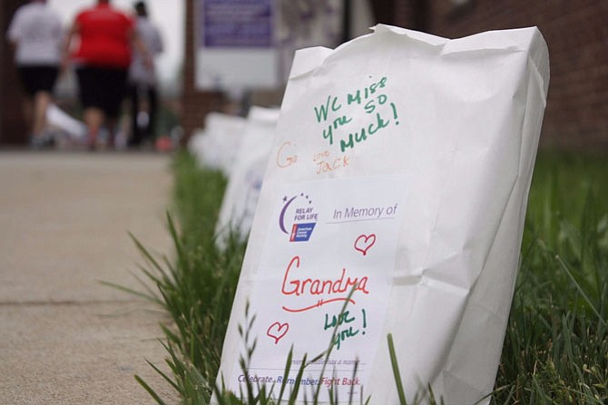Bags with heartfelt messages line the event, encouraging the participants.