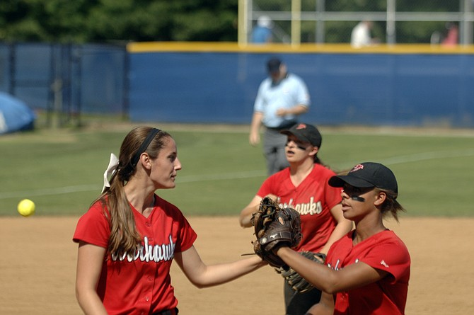Madison left fielder Peyton Thomas, right, greets pitcher Katie Vannicola during the Warhawks' 4-0 win over Grassfield in the 6A state semifinals on Friday. Vannicola threw her first high school no-hitter, helping the Warhawks return to the state final for the first time since 2004.