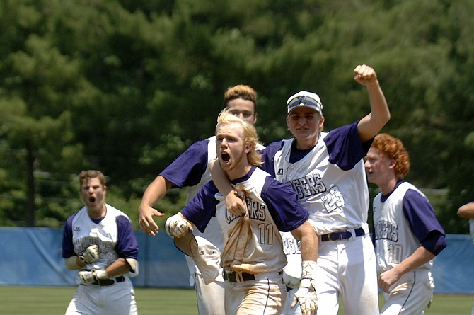 Teammates celebrate with Jared Enders (11), whose walk-off RBI single gave the Chantilly baseball team a 3-2 win over Battlefield in Saturday's 6A state championship game.