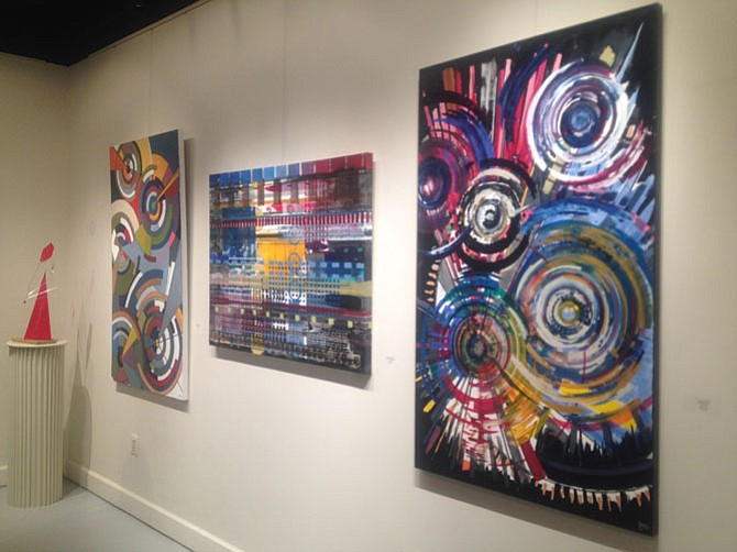 Several of the bold paintings by Reston resident Sherwood Gainer which are on display at ArtSpace Herndon in downtown Herndon. The exhibit will close on June 26.