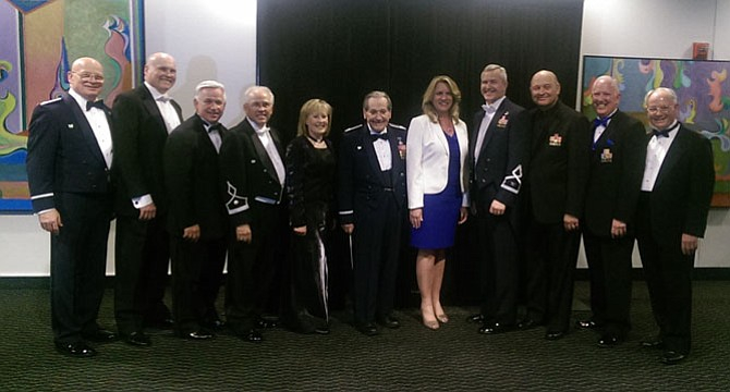 The U.S. Air Force Band 75th Anniversary Reunion Concert brought back former conductors including (from left) Col. (Ret.) Dennis Layendecker, Lt. Col. (Ret.) Mark Peterson of Fairfax Station, Lt. Col. (Ret.) Craig Jessop, Lt. Col. (Ret.) Phillip Carl Chevallard, Lt. Col. (Ret.) Amy Mills, Col. (Ret.) Arnald Gabriel, Secretary of the Air Force Deborah James, current Air Force Band conductor Col. Larry Lang, Col. (Ret.) Lowell Graham, Lt. Col. (Ret.) Alan Sierichs and Col. (Ret.) H. Bruce Gilkes.