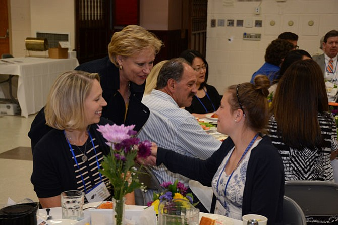 Fairfax County Public Schools Superintendent Dr. Karen Garza (left) visits with 2016 Robinson Secondary School graduate and Fairfax Station resident Wesley Kittelberger (right) at the Fairfax County Retired Educators luncheon June 9.