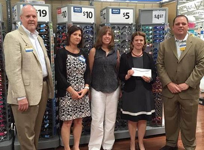 Our Daily Bread Board of Directors Member Catherine Read (second from right) and Programs Director Christina Garris (center) receive a grant check from Walmart Market Managers (from left) George Joyner, Leigh Belcher and Rodney Morrison at an award ceremony on May 26 at the Walmart Fredericksburg on Carl D. Silver Parkway.