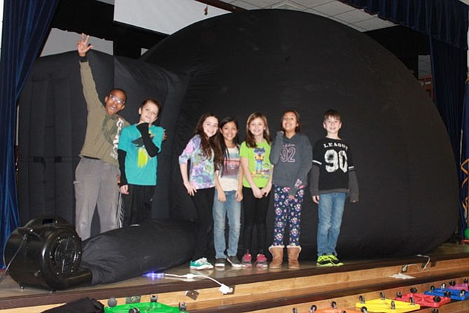 Students at Park Ridge Elementary stand outside Marymount University's Myhill Portable Planetarium. They were concluding their study of the solar system. From left are D'Brickshaw Davis, Jackson Dixon, Sofia Bragin, Lily Canales, Bailey Gibson, Isabella Mayorga and Chase Krause.