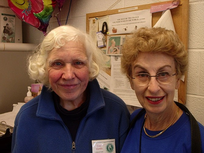 Longtime volunteers Eleo Worth (left) and Ellen Flynn. Ms. Flynn has served the Animal Welfare League of Alexandria for 45 years.