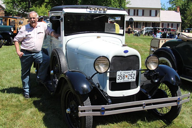 Rick Heyer poses with the 1930 Ford ice cream truck he restored after finding it sitting in a barn for more than 30 years. Fully operational, Heyer keeps the ice cream in the back cool with dry ice.