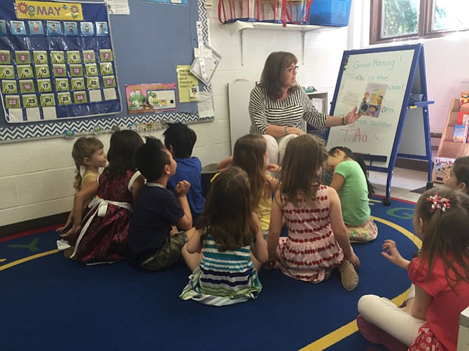 Preschool teacher Carolyn Garrett reads a story to students at Christ Presbyterian Church off Route 50 in Fairfax.