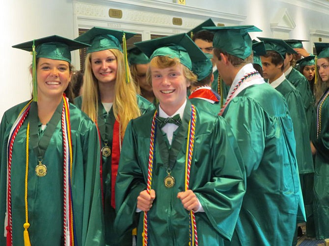 Michaela Christine Purdy, Audrey Elizabeth Fahlberg and Brendan Thomas Coffey pave the route toward graduation.