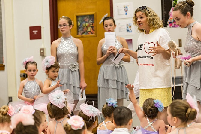 Julie Houghton has help from her daughter as well as the older dance students in organizing all of the children for their performances.