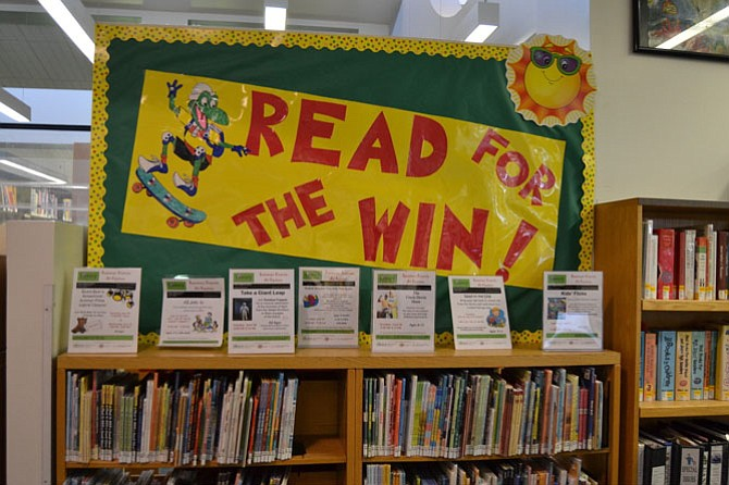 "The ""Read to Win"" bulletin board, made by one of the staff members at the Reston Regional Library."
