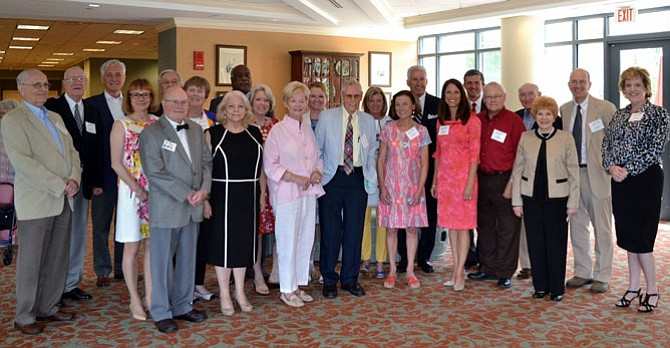 Current and past board members for Senior Services of Alexandria gather for a photo at the SSA annual luncheon June 22 at Goodwin House.