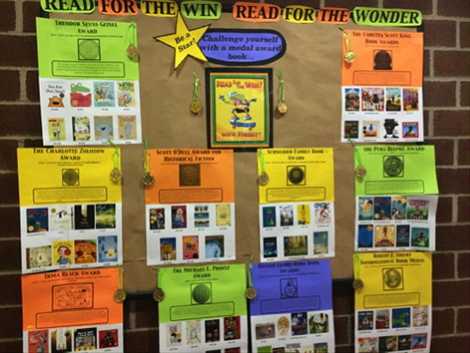 Bulletins boards are hung around the Herndon Fortnightly to encourage children to read a wide array of award winning books.