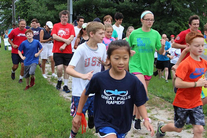 More than 100 people participated in the 5k run hosted by the Great Falls Trail Blazers on the morning of July 4. The run begins at the Freedom Memorial and ends in the field behind the library.