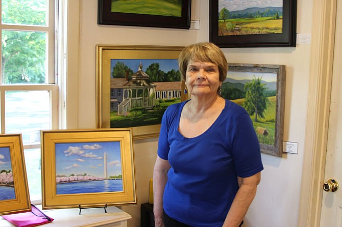Coty Dickson showcases her work at the Artists on the Green studio in Great Falls Village. Her work is often of landscapes done in oil paint.