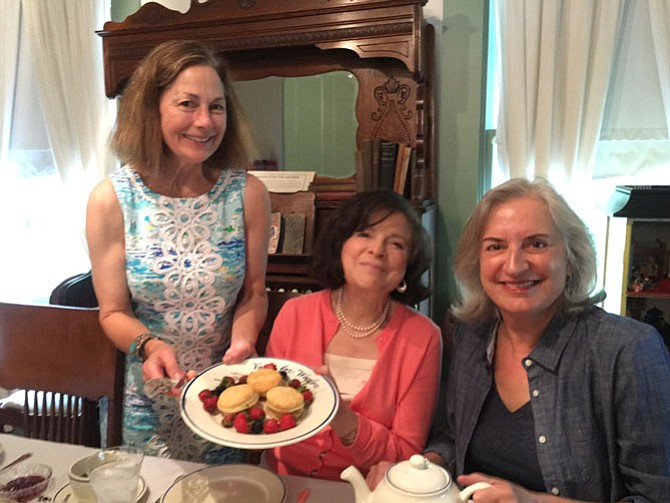"""Nancy Moats of Historic Vienna, Inc. co-hosted the """"tea"""" featuring 19th-century social activist Elizabeth Cady Stanton. Guests Nedda R. Thomas [left, seated] and Kata Baroloni-Tuazon support HVI's programs."""