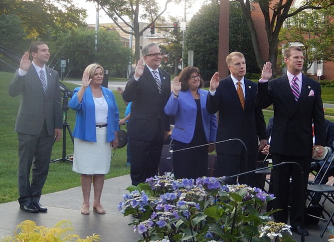 (From left) Jon Stehle, Janice Miller, Michael DeMarco, Ellie Schmidt, David Meyer and Jeff Greenfield are sworn in.