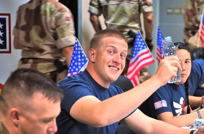 A great Fourth of July: American troops open packages from Reston Chorale.