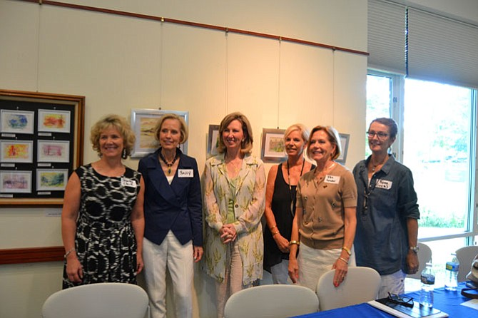 From left: Shirley Clark, the CEO and executive director of the Women's Center in Vienna; Sally Turner, the president and chair of the Women's Center Board of Directors; U.S. Rep. Barbara Comstock (R-10), who hosted the event; and representatives of Women Giving Back -- Terri Stagi, the president of the executive committee; Pat Leader, the secretary and treasurer; and Fiona Hughes, the vice president.