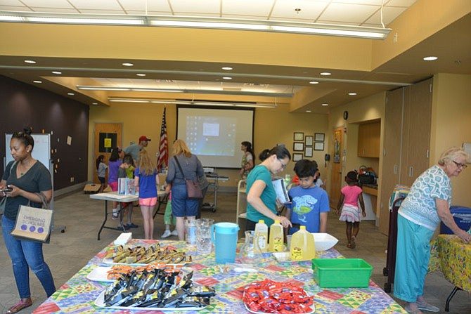 Families enjoy themselves attending the Burke Centre Library's kick-off event for the summer reading program.