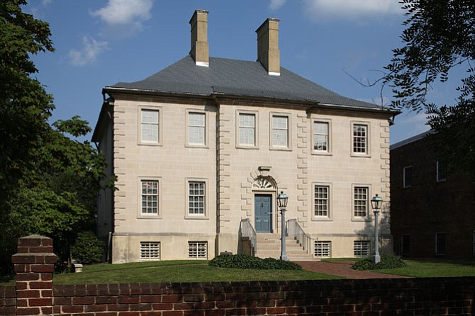 John Carlyle built the Carlyle mansion for his wife Sarah Fairfax. Scotland's stone architectural culture influenced Carlyle, and his use of stone was unique for the Alexandria area where wooden structures were the norm.
