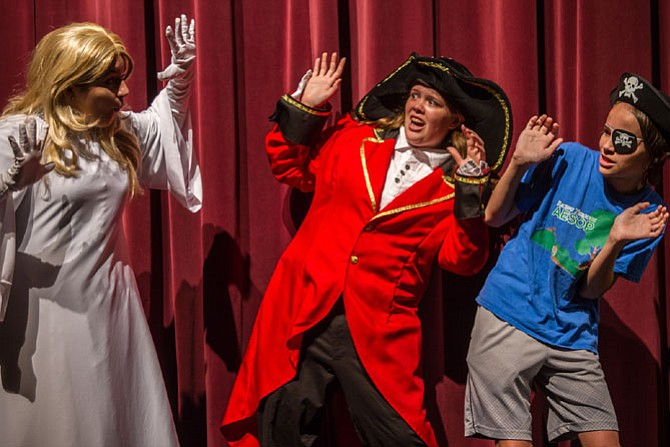 From left: Megan Dinnenn (Harriet the Ghost), Samantha York (Capt. Cranky Bones) and Jared Belsky (Theodore) rehearse a scene.