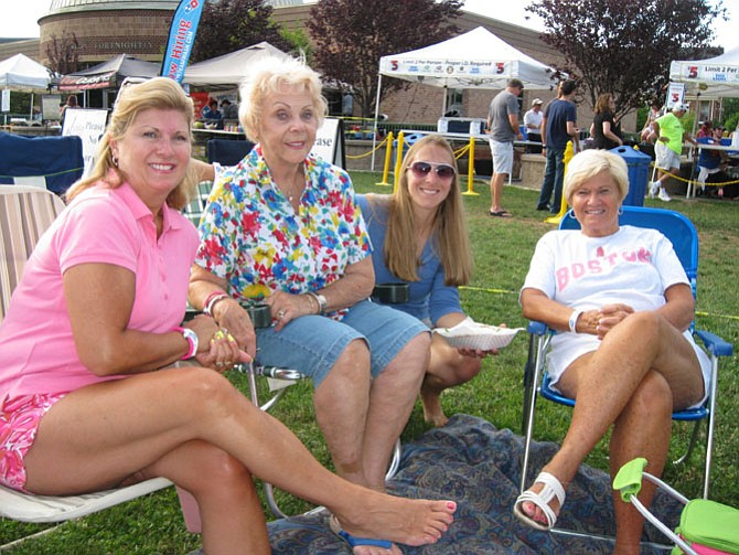 Nancy Wood of Herndon, Dottie Bartholomew of Stuart, Fla., Debbi Perla of Westminster, Md., and Kelly Burishkin of Acushnet, Mass, enjoy the concert.