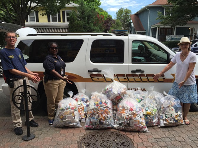 Volunteer Cullen Prall, Sheriff's Deputy Valarie Wright, and SAPCA Vice Chair Shelly Morgan, stand with full bags of unused, unwanted and expired prescription drugs.
