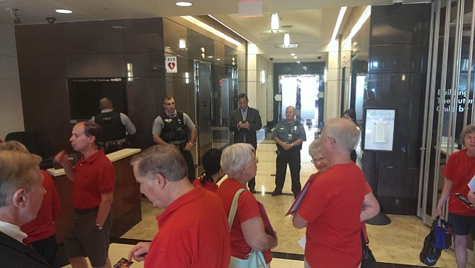 Security initially formed a line between demonstrators and the hallway to the Fairfax County School Board work session on July 21, but eventually they were allowed through.