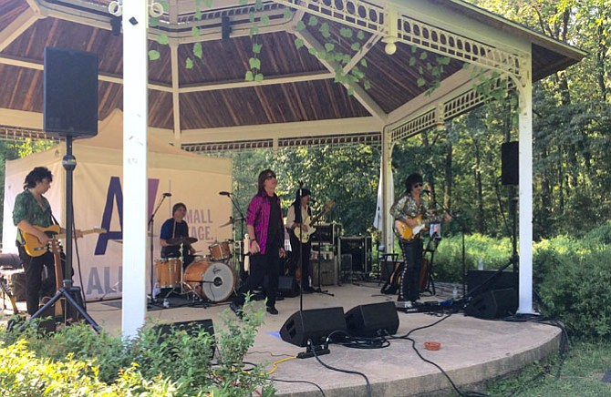 Satisfaction performs at McLean Central Park. Frontman Chris LeGrand, who plays Mick Jagger in Satisfaction's shows, founded the group in 2001.