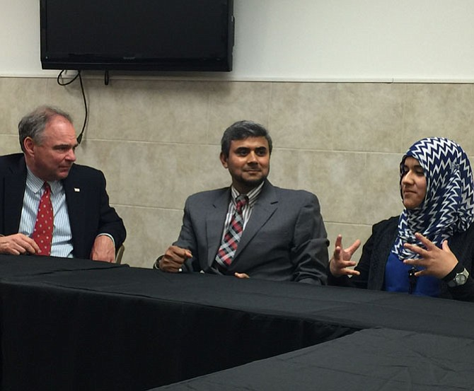 Sen. Timothy M. Kaine (D-VA) listens to student Hidayah Martinez Jaka, who talked about her personal experiences with intolerance and prejudice towards Muslims, during a roundtable discussion Kaine hosted with leaders of the Northern Virginia interfaith and civil rights communities on Thursday, July 21 at the All Dulles Area Muslims Society (ADAMS) Center.