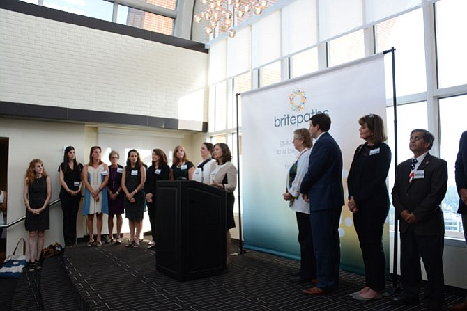 Executive Director Lisa Whetzel (center) announces the name change of Our Daily Bread to Britepaths at Tower Club Tysons Corner.