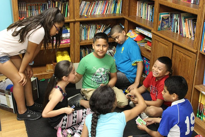 "Students in Community Lodgings' summer learning program play ""Uno"" during a short break."