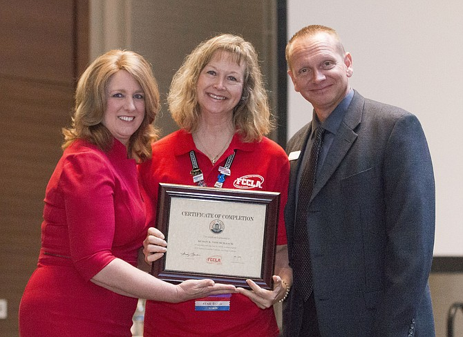 Lanier teacher Susan von Schaack, center, is honored by Sandy Spavone, FCCLA executive director, and Peter Martinovich, an educational consultant at Goodheart-Willcox.