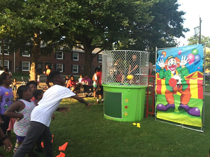 A dunk tank set up at the Tancil Court location for National Night Out.