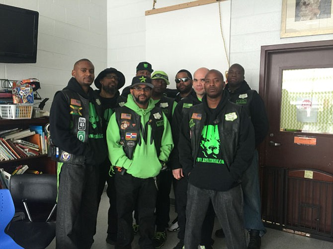 Members of the local chapter of the K9 Motorcycle Club gather at the Animal Welfare League of Alexandria. The men performed several hours of volunteer work for the shelter's animals.