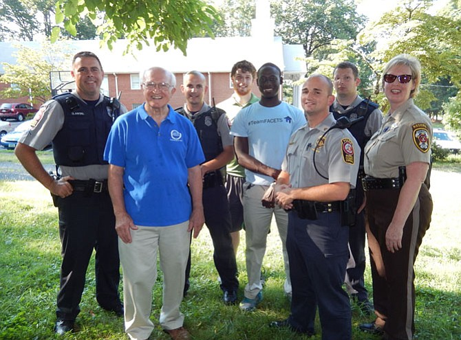 Church, FACETS and law-enforcement personnel gather for a photo in Ragan Oaks.