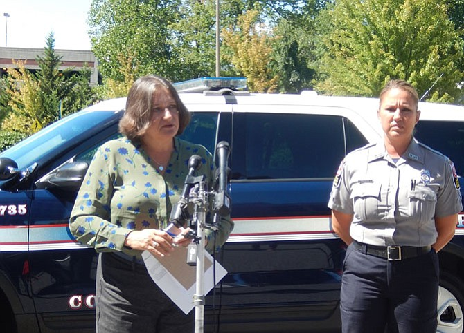 Judy Pedersen (left) and Monica Meeks at a press briefing, Sunday afternoon, outside police headquarters in Fairfax.