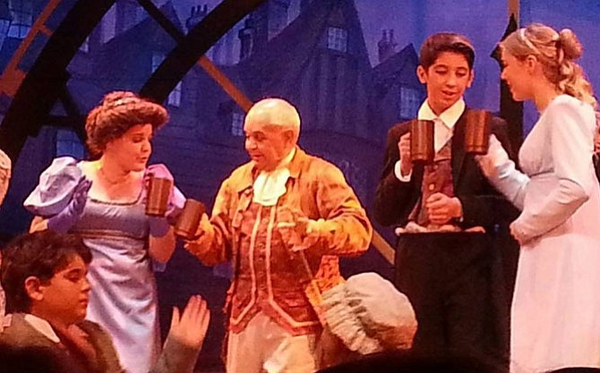 Roland Branford Gomez, center, as Fezziwig in last year's LTA production of A Christmas Carol.