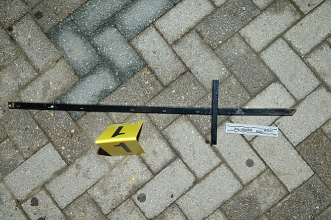 Police later released a photo of the apparent weapon, which turned out to be a metal signpost with a sharp end used for driving into the ground.
