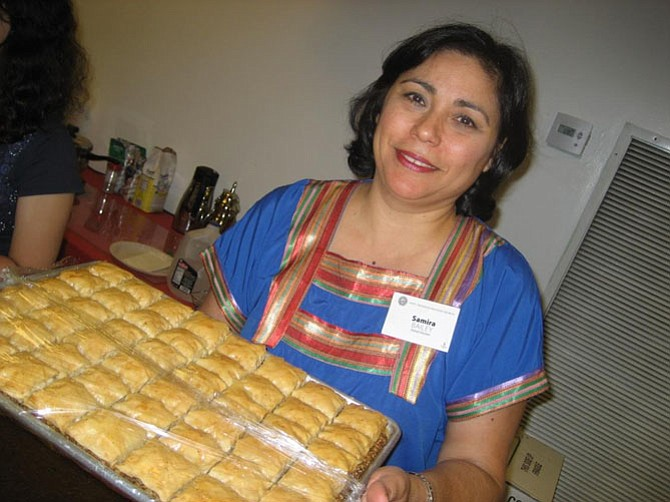 Samira Bailey holding a tray of baklava