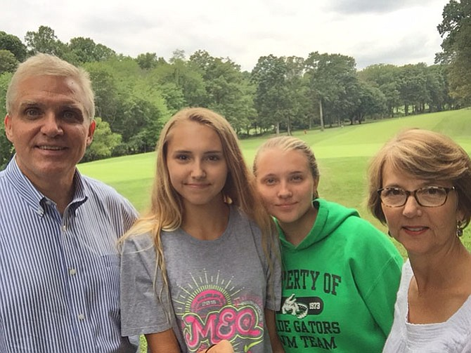 McCrea Family, from left --  John, Kellie, Natalie, Trudy enjoying the open space on the RA path behind the 13th green. Rescue Reston has reached a matching $5000 Challenge Goal set by John McCrea, President of Achieve-It, LLC, a Green Jacket sponsor of the 2016 tournament.